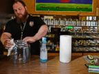 PHOTO: Kurt Britz cleans jars that will hold recreational marijuana at 3D Cannabis Center in Denver, Dec. 30 2013.