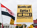 PHOTO: Protesters rally in front of the White House against the use of military force in Syria, Sept. 9, 2013.