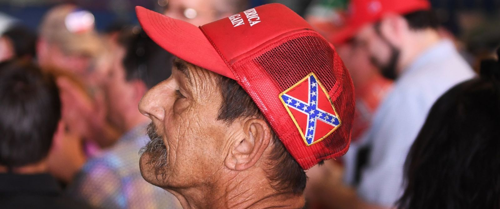 "PHOTO: A man has a confederate flag on his ""Make America Great"" hat during a Donald Trump rally at the Wings Over the Rockies Museum in Denver, July 29, 2016."
