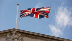 PHOTO: A British Union Flag, also know as a Union Jack, flies above the Bank of England (BOE) in the City of London, June 20, 2016.