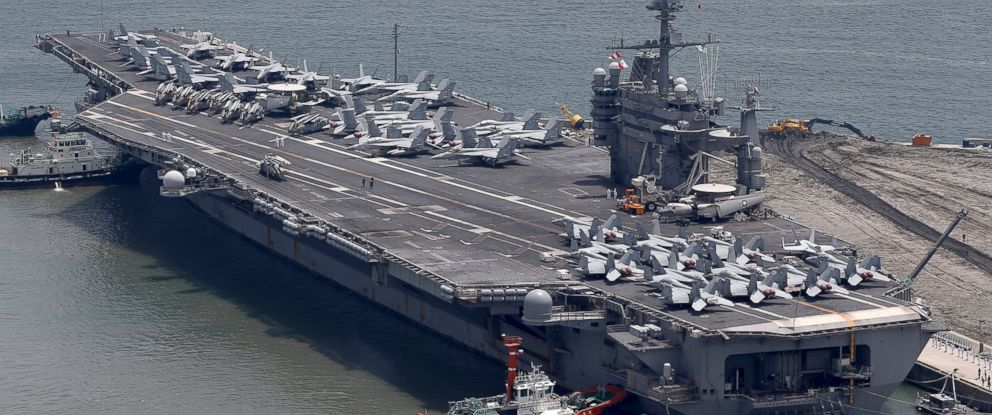 PHOTO: US aircraft carrier USS George Washington sits at anchor in Busan port, July 11, 2014, in Busan, South Korea.