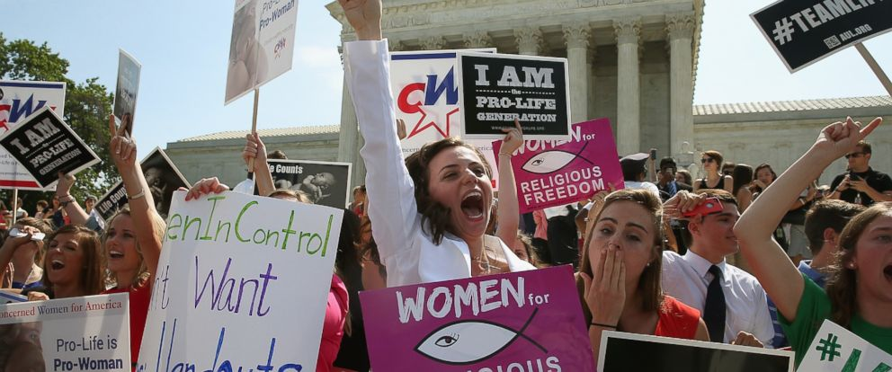 PHOTO: Hobby Lobby supporters react to the U.S. Supreme Court decision June 30, 2014 in Washington, DC.