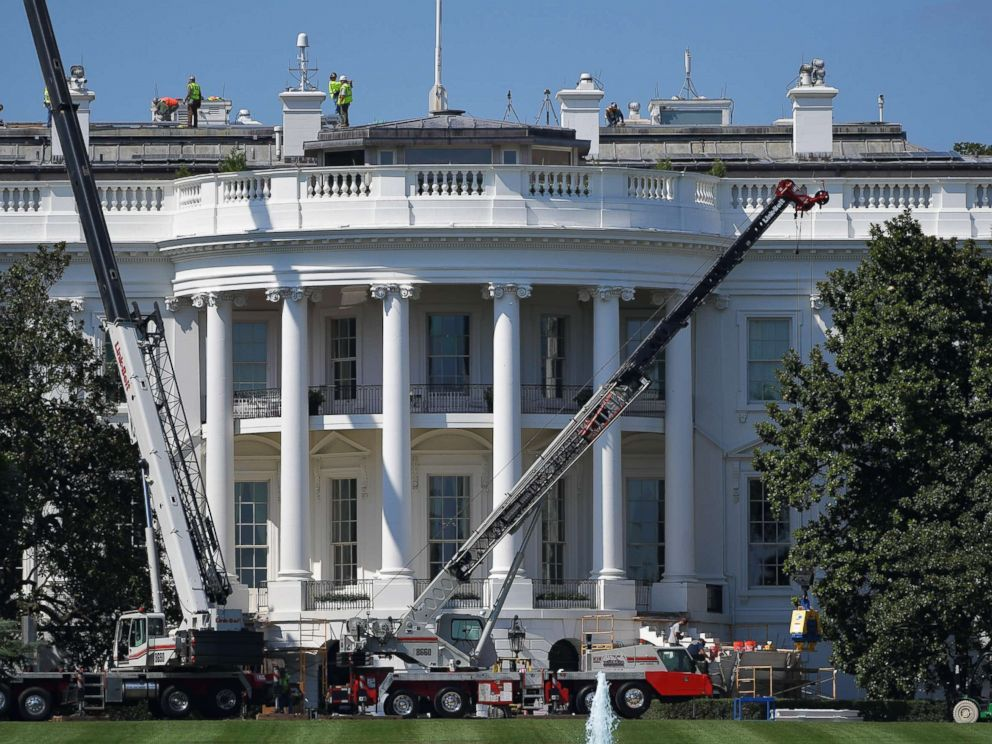 PHOTO: Cranes are seen infront of the south front of the White House as it undergoes renovations on August 9, 2017 in Washington, DC.
