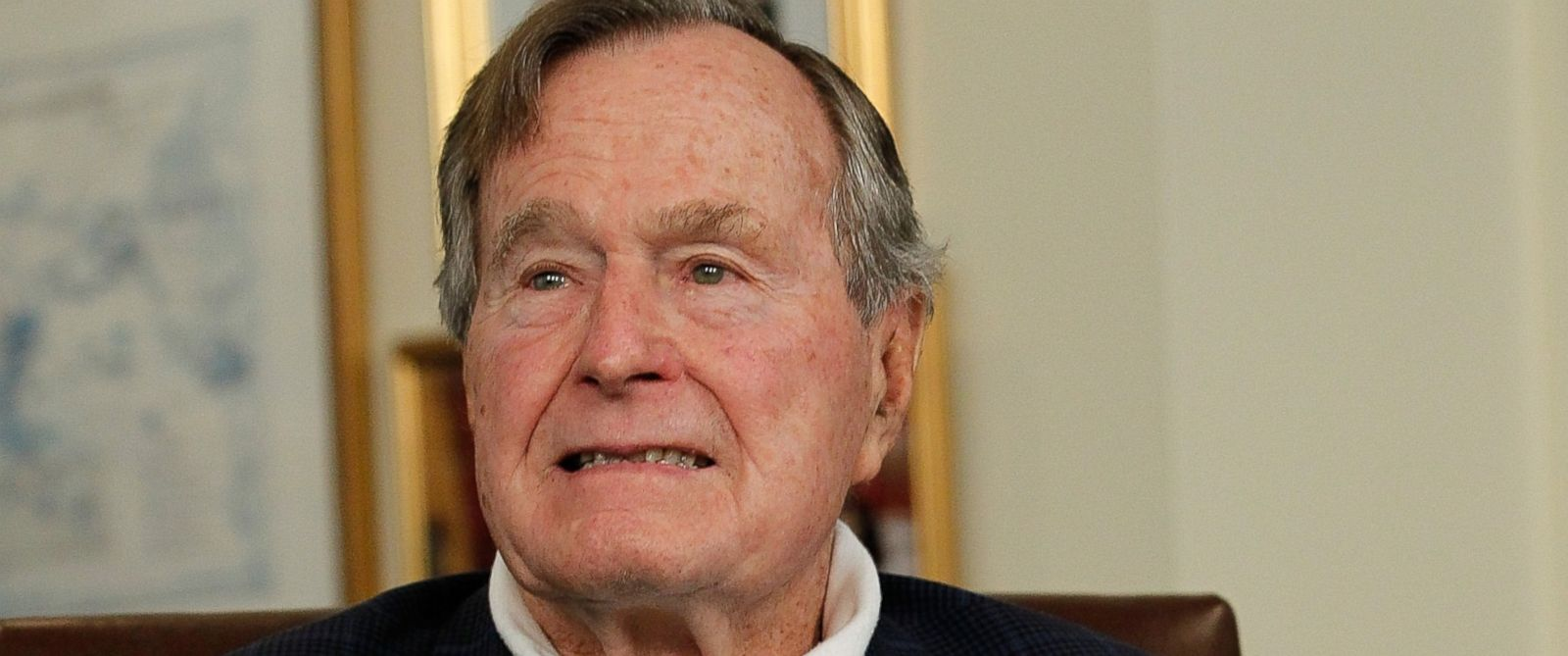 PHOTO: Former President George H.W. Bush talks with Republican presidential candidate, former Massachusetts Gov. Mitt Romney at Bushs office, March 29, 2012 in Houston, Texas.