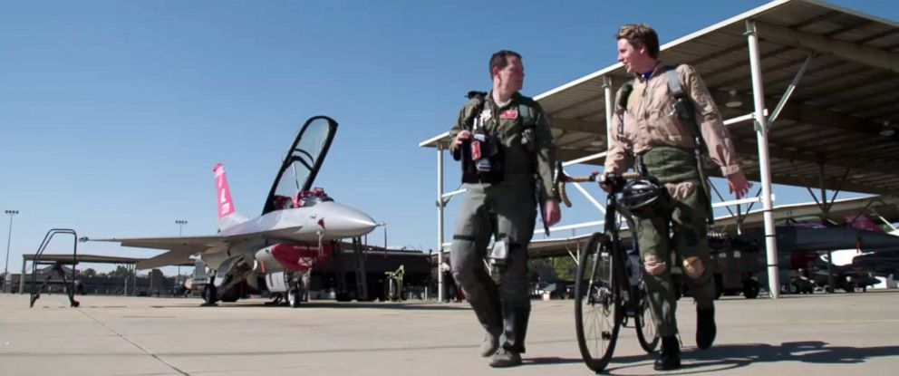 "PHOTO: Captain Jeffrey ""Split"" Witt walks with ABC News Michael Koenigs on runway after ride in F-16 Fighter."