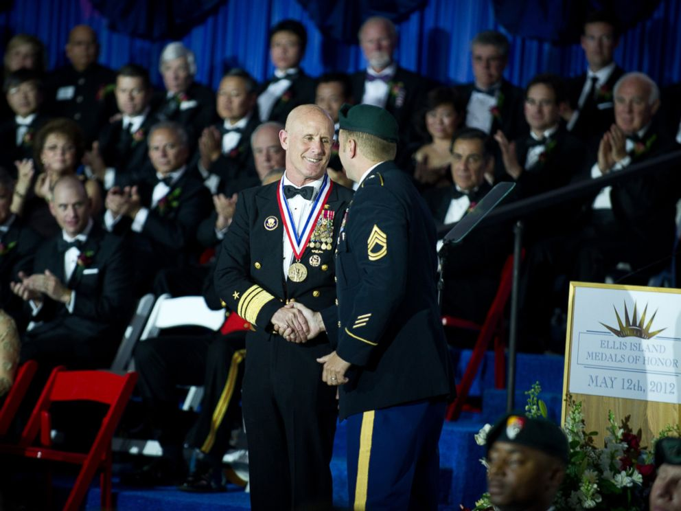 PHOTO: U.S. Navy Vice Adm. Robert S. Harward receives the Ellis Island Medal of Honor Award from a U.S. Army Special Forces soldier during a ceremony, May 12, 2012, at Ellis Island in New York.