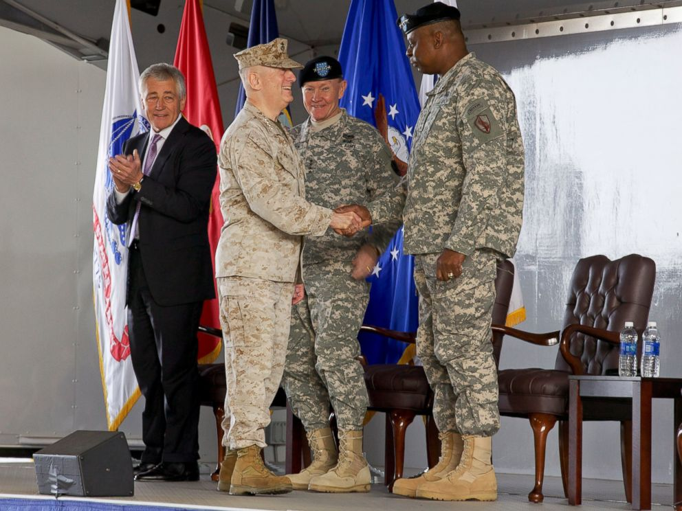 PHOTO: U.S. Marine Corps Gen. James N. Mattis, left foreground, shakes hands with Army Gen. Lloyd J. Austin III during the U.S. Central Command change of command ceremony March 22, 2013, at MacDill Air Force Base, Fla.