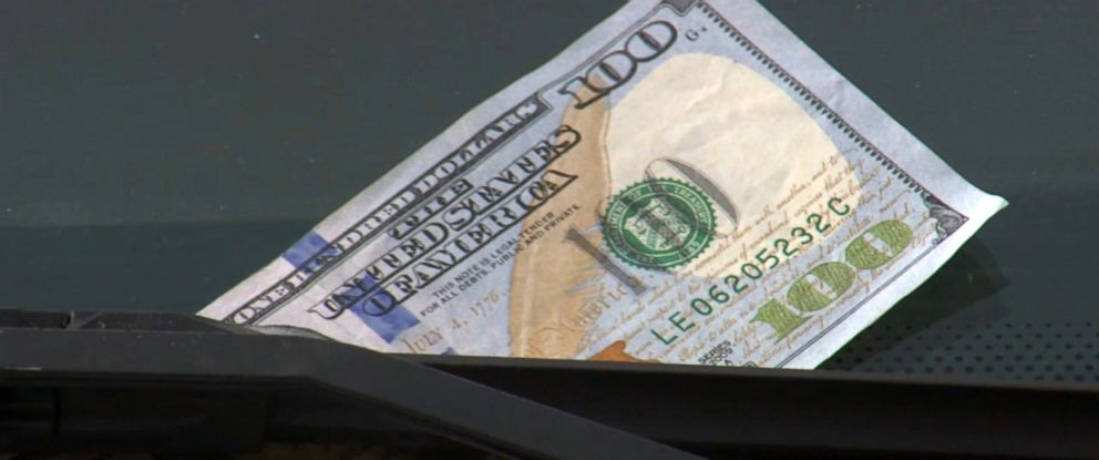 PHOTO: If you see a $100 bill on your windshield, don't immediately try to retrieve it.