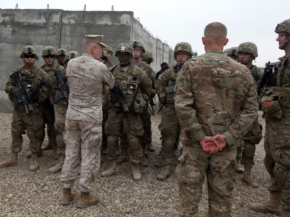 PHOTO: United States Central Command Commander, Gen. James N. Mattis, speaks with paratroopers assigned to Task Force 1 Panther, before they prepare to depart for a mission, Camp Jordania, Afghanistan, Dec. 27, 2011.