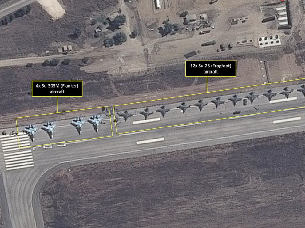 PHOTO: This satellite image taken on September 20 and released by AllSource Analysis four SU-30 Flanker fighters and 12 SU-25 Frogfoot fighters can be seen on a runway at the Bassel Al-Assad International Airport in Latakia, Syria.