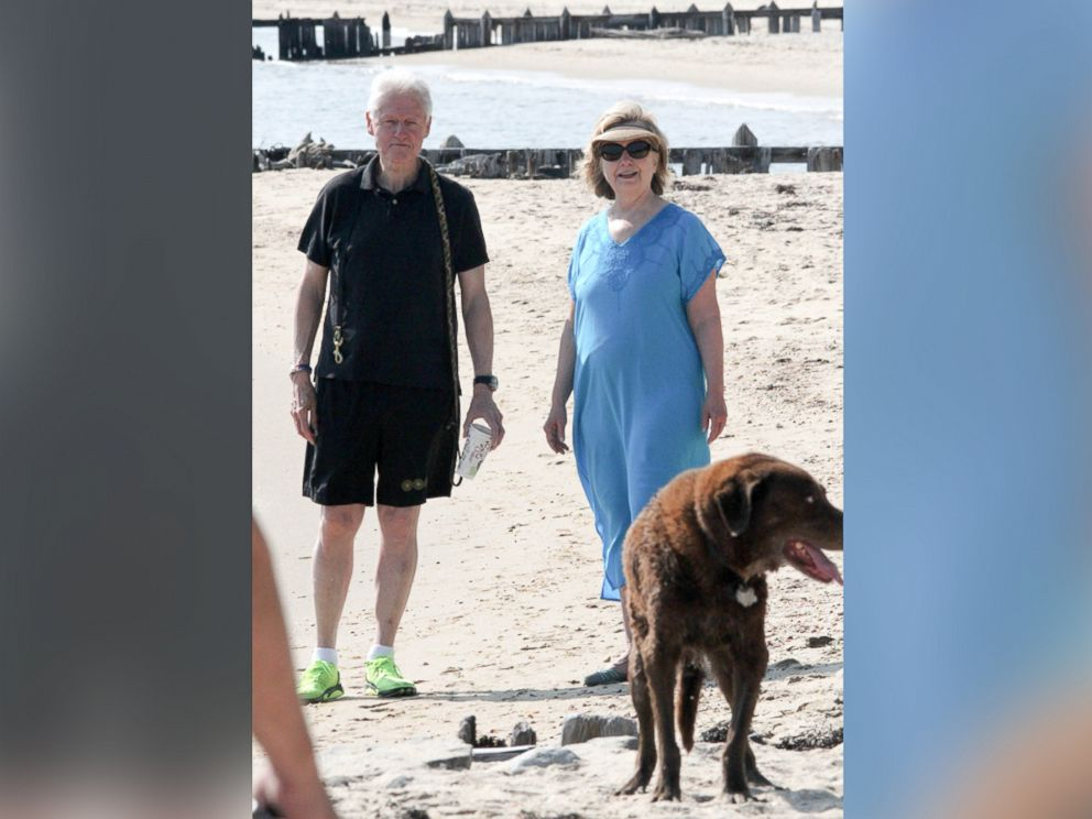 PHOTO: Former POTUS Bill Clinton and wife, former Secretary of State Hillary Rodham Clinton are seen enjoying a leisurely morning on the beach with their dogs in the Hamptons, N.Y., Aug. 8,2014.