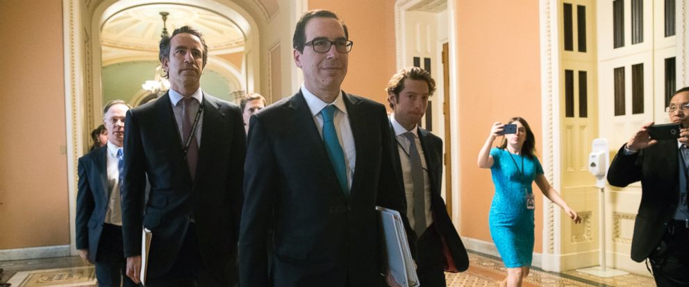 Treasury Secretary Steven Mnuchin arrives at the Capitol for a meeting with Senate Majority Leader Mitch McConnell, R-Ky., and members of the Senate Budget Committee as they struggle with a tax code overhaul, Sept. 12, 2017 in Washington.