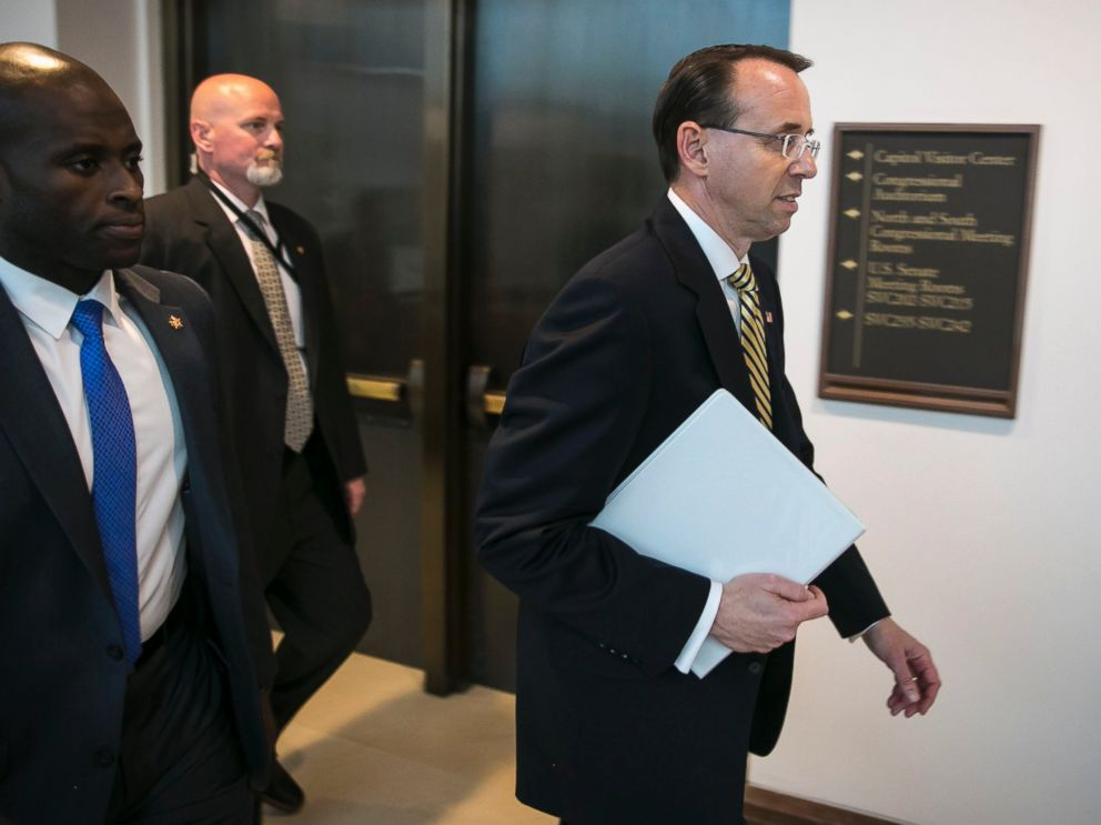 PHOTO: Deputy Attorney General Rod Rosenstein, right, following a closed-door meeting with Senators on Capitol Hill, May 18, 2017.