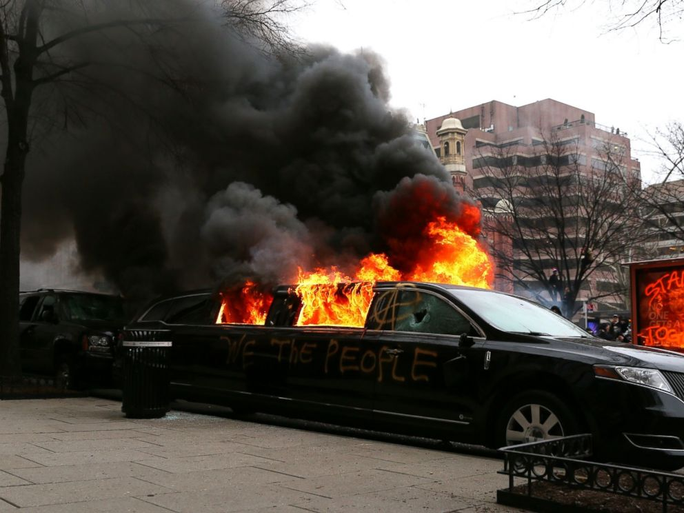 PHOTO: Protesters set fire to a limousine in the street, Jan. 20, 2017, in Washington.