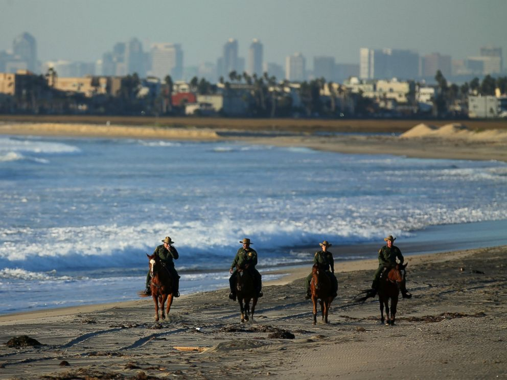 PHOTO: U.S. Border Patrol agents on horseback patrol along a beach just north of the U.S. and Mexico border near San Diego, Calif., Nov. 10, 2016.