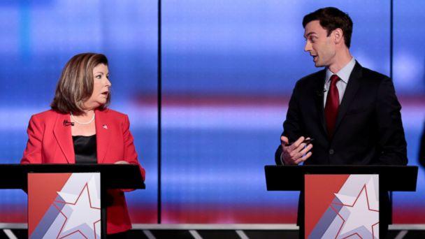 PHOTO: Republican candidate Karen Handel and Democratic candidate Jon Ossoff exchange words before Georgia's 6th Congressional District special election debate at WSB-TV studios in Atlanta, June 6, 2017.