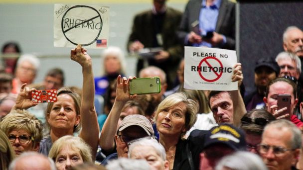 PHOTO: Constituents of Virginia's 2nd District hold up signs during a town hall meeting held by U.S. Representative Scott Taylor (R-VA) at Kempsville High School in Virginia Beach, Virginia, Feb. 20, 2017.