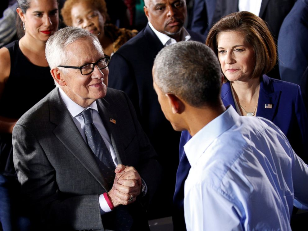 PHOTO: President Barack Obama is greeted by Senate Democratic leader Harry Reid (L) and Senate candidate Catherine Cortez Masto (R) during rally in support of Hillary Clintons campaign in Las Vegas, Oct. 23, 2016.