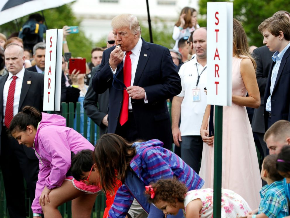 PHOTO: President Donald Trump blows a whistle to start the White House Easter Egg Roll on the South Lawn of the White House in Washington, April 17, 2017.