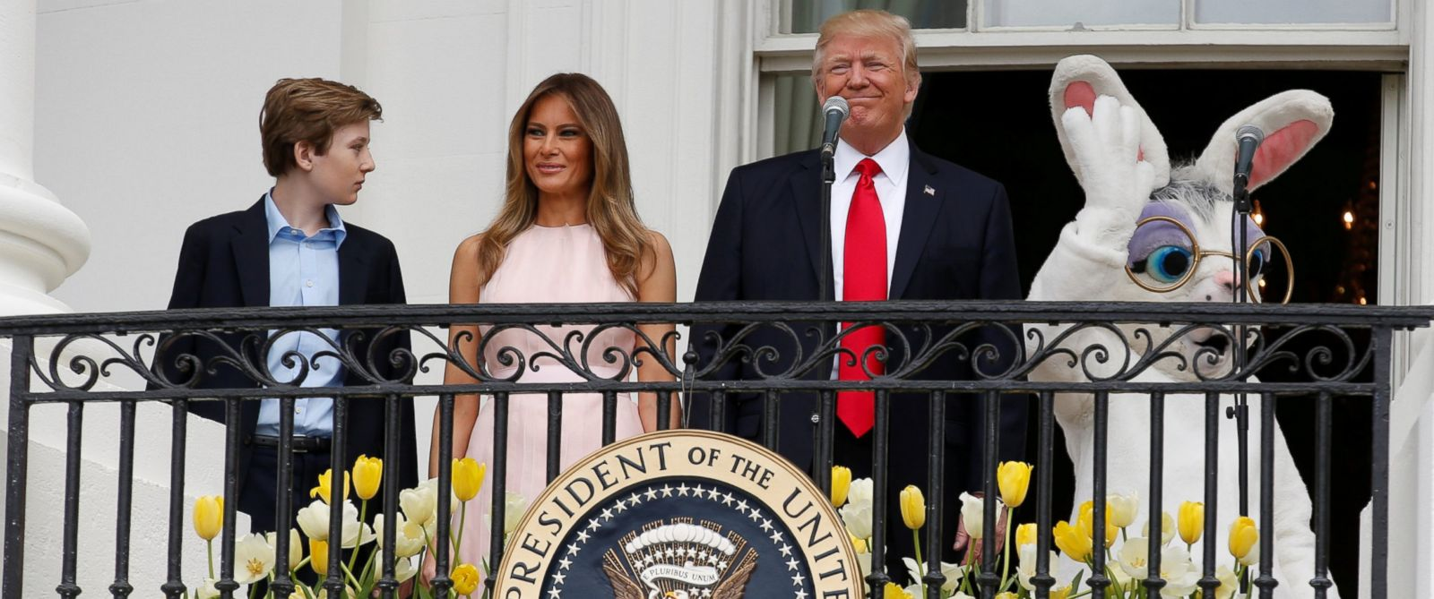 PHOTO: President Donald Trump stands with his son Barron, first lady Melania Trump and a performer in an Easter Bunny costume on the Truman Balcony during the White House Easter Egg Roll in Washington, April 17, 2017.