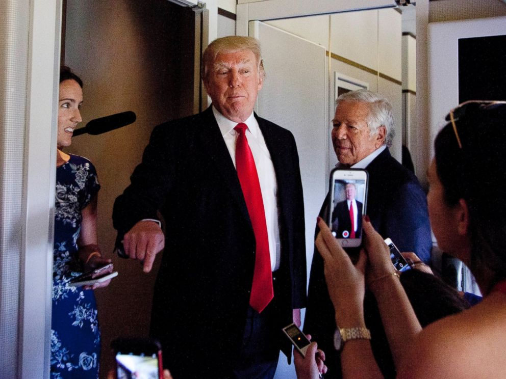 PHOTO: President Donald Trump talks to press corps inside Air Force One at the Palm Beach International Airport, March 19, 2017, in West Palm Beach, Fla.