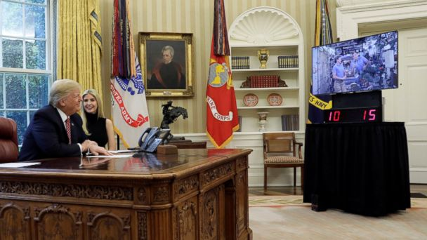 President Donald Trump and his daughter Ivanka hold a video conference call with Commander Peggy Whitson and Flight Engineer Jack Fischer of NASA on the International Space Station from the Oval Office of the White House in Washington, April 24, 2017.