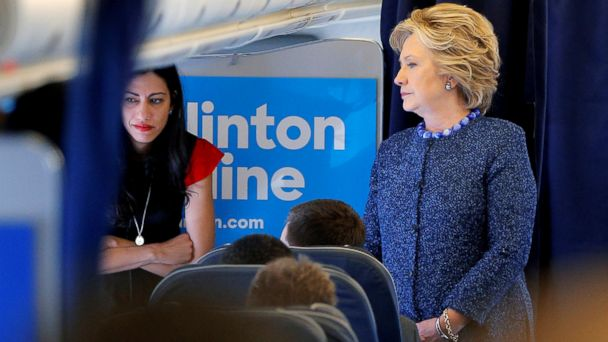 PHOTO: Democratic presidential nominee Hillary Clinton talks to staff members, including aide Huma Abedin, onboard her campaign plane in White Plains, New York,October 28, 2016.