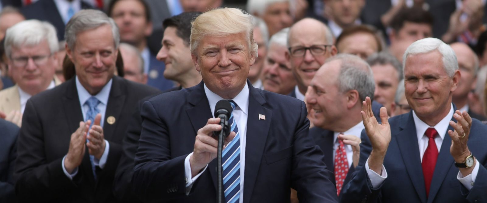 PHOTO: President Donald Trump gathers with Vice President Mike Pence, right, and Congressional Republicans in the Rose Garden of the White House after the House of Representatives approved the American Healthcare Act, May 4, 2017.