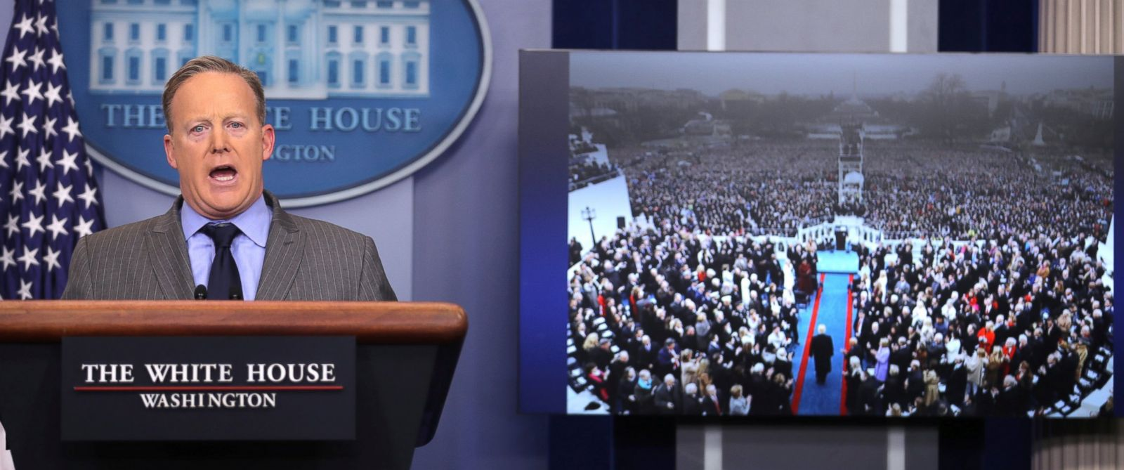 PHOTO:Press Secretary Sean Spicer delivers a statement while television screen show a picture of U.S. President Donald Trumps inauguration at the press briefing room of the White House in Washington, January 21, 2017.