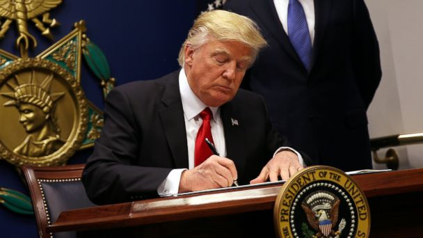 PHOTO: President Donald Trump signs an executive order to impose tighter vetting of travelers entering the United States, at the Pentagon in Washington, January 27, 2017.