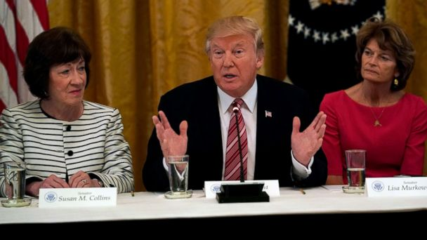 PHOTO: President Donald Trump meets with Senate Republicans about healthcare in the East Room of the White House, June 27, 2017. Trump is flanked by Senators Susan Collins,left, (R-ME) and Sen. Lisa Murkowski,(R-AK).