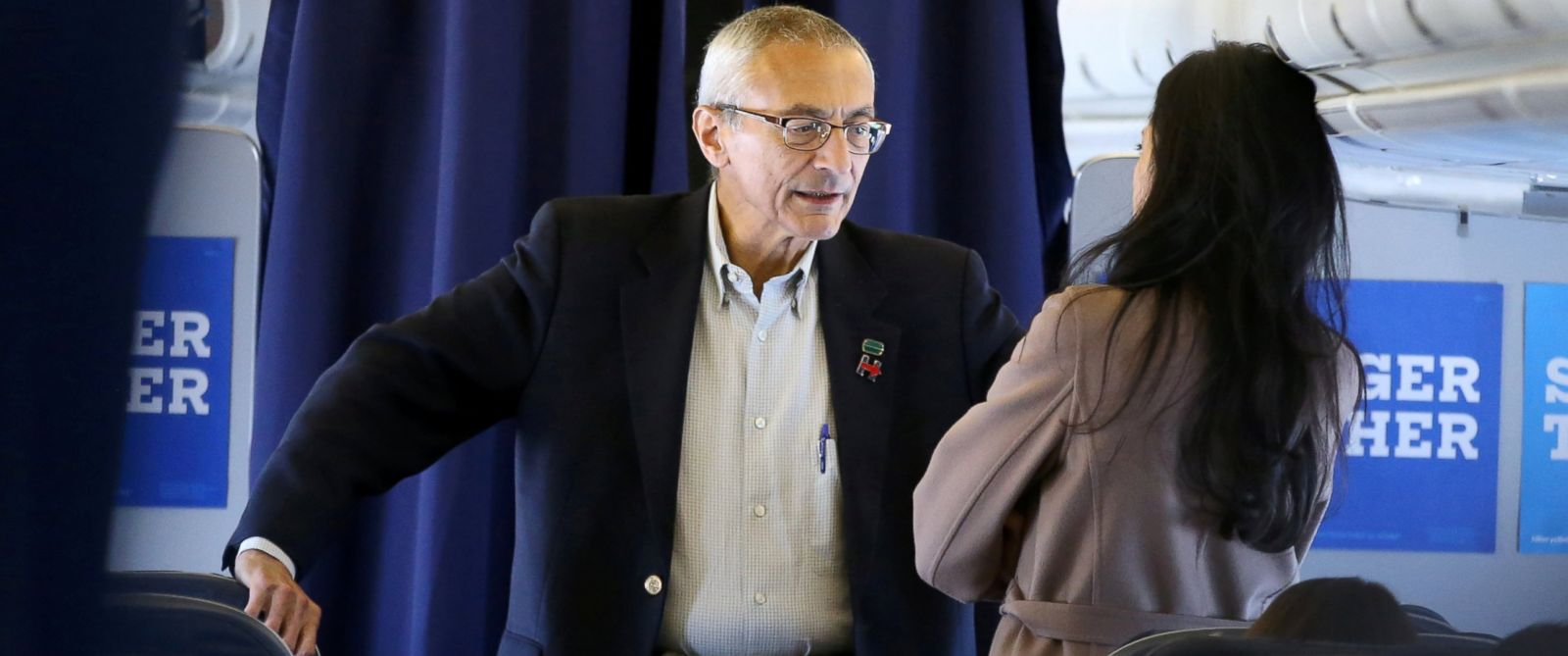 PHOTO:Campaign Manager John Podesta, left, speaking to senior advisor Huma Abedin on the Hillary Clinton campaign plane from New York enroute to Miami, October 11, 2016.