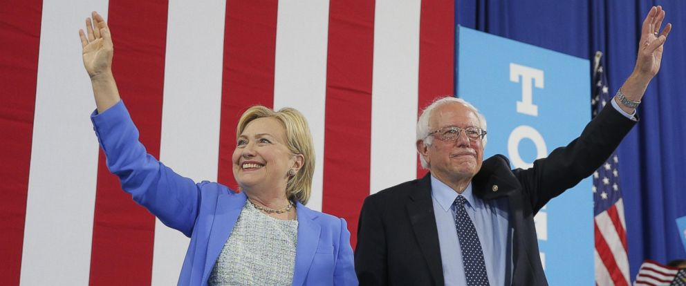 PHOTO: Democratic U.S. presidential candidate Hillary Clinton and Sen. Bernie Sanders stand together during a campaign rally where Sanders endorsed Clinton in Portsmouth, New Hampshire, July 12, 2016.