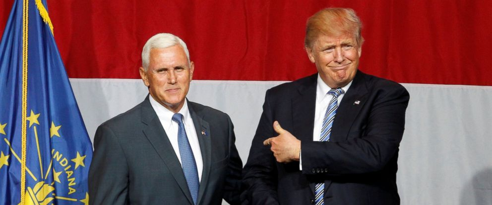 PHOTO: Republican presidential candidate Donald Trump (R) and Indiana Governor Mike Pence (L) wave to the crowd before addressing the crowd during a campaign stop at the Grand Park Events Center in Westfield, Indiana, July 12, 2016.