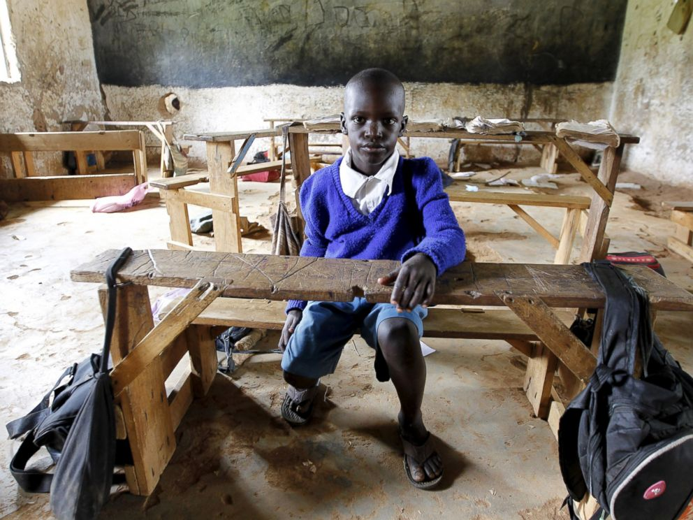 PHOTO: Seven-year-old Barack Obama Okoth, named after President Barack Obama, sits inside an empty classroom as he speaks with Reuters at the Senator Obama primary school in Nyangoma village in Kogelo, west of Kenyas capital Nairobi, June 23, 2015.
