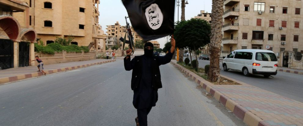 PHOTO: A member loyal to the Islamic State in Iraq and the Levant waves an ISIL flag in Raqqa, Syria in this June 29, 2014, file photo.