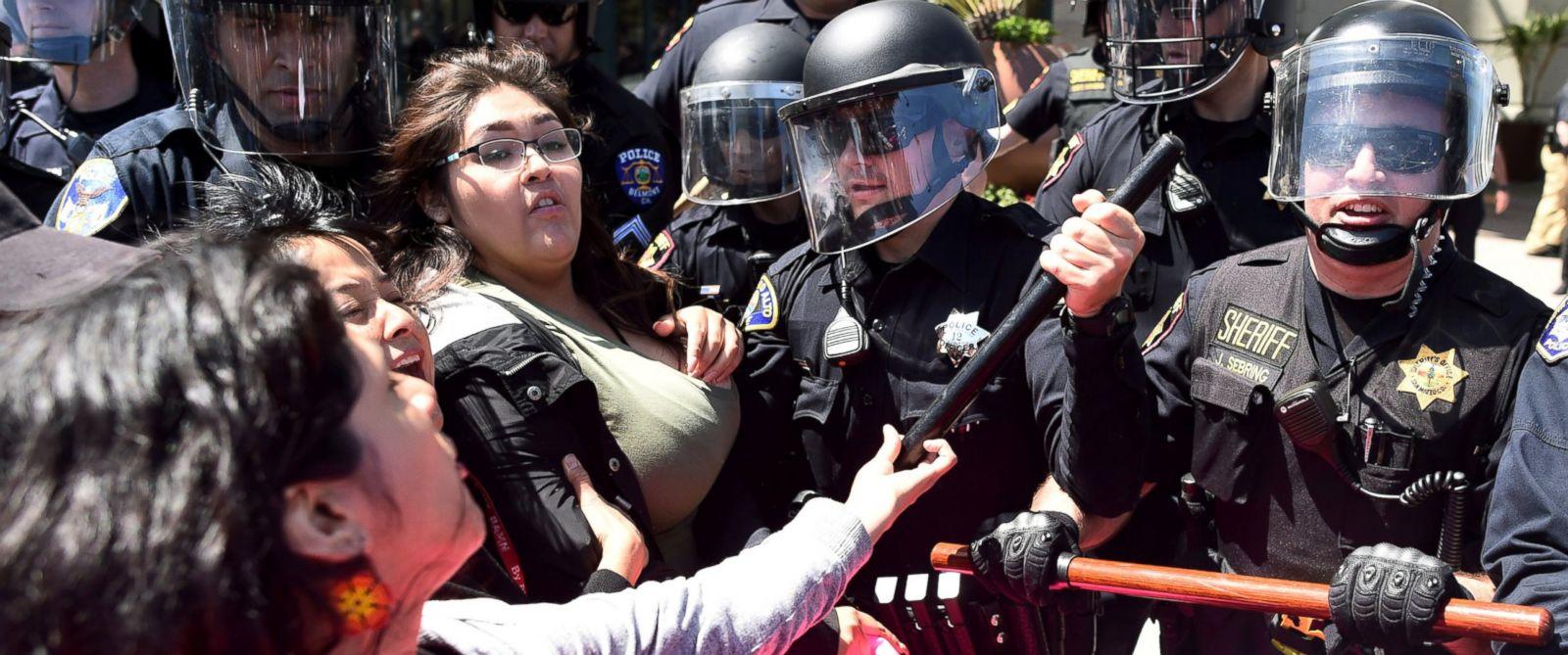 PHOTO: Police in riot gear hold back demonstrators protesting Donald Trump outside the Hyatt hotel in Burlingame, Calif., April 29, 2016.