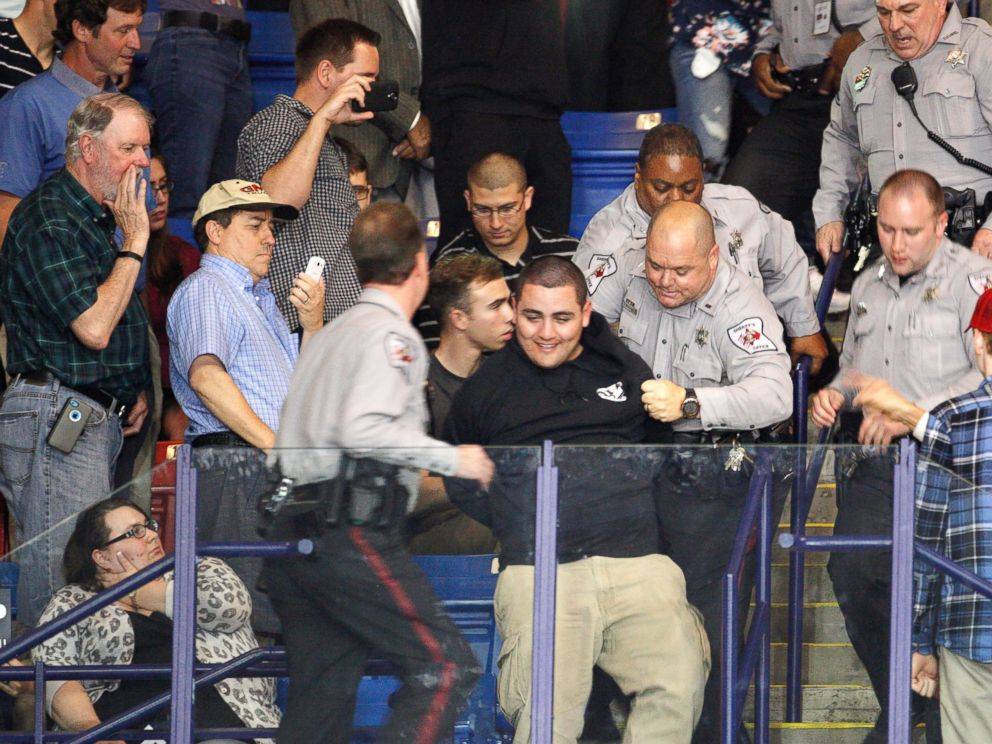 PHOTO: Police officers forcibly remove a protester at U.S. Republican presidential candidate Donald Trumps campaign rally in Fayetteville, North Carolina March 9, 2016.