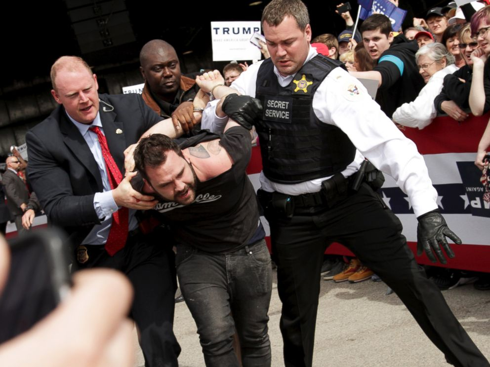 PHOTO: U.S. Secret Service agents detain a man after a disturbance as Republican presidential candidate Donald Trump spoke at Dayton International Airport in Dayton, Ohio, March 12, 2016.