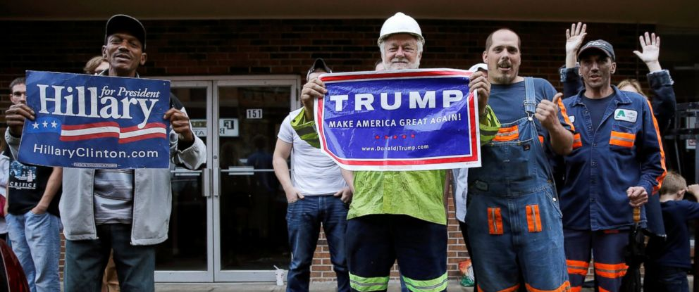 PHOTO: Supporters of Democratic presidential candidate Hillary Clinton and Republican presidential candidate Donald Trump cheer outside a campaign event in Williamson, West Virginia, May 2, 2016.