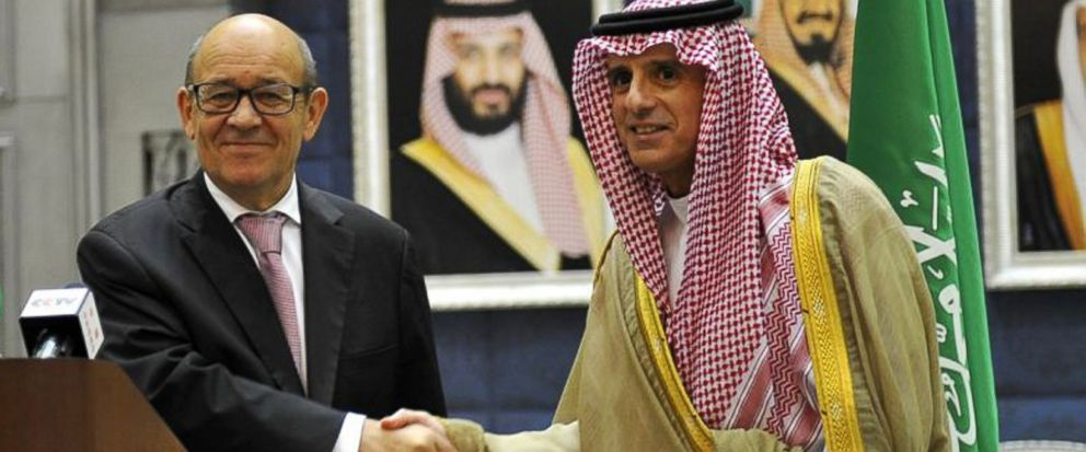 In this Saturday, July 15, 2017 photo released by Saudi Press Agency, Saudi Foreign Minister Adel al-Jubeir, right, shakes hands with France Foreign Minister Jean-Yves Le Drian during a join press conference in Jiddah, Saudi Arabia. Frances foreign
