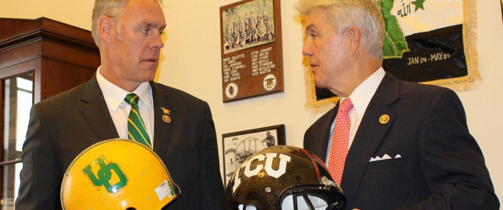 PHOTO: Rep. Roger Williams (R-TX) and Rep. Ryan Zinke (R-MT) make their friendly wagers over the outcome of the Jan. 2 Alamo Bowl.