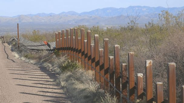 PHOTO: There are a number of different types of fencing used along the border, some less difficult to climb than others.