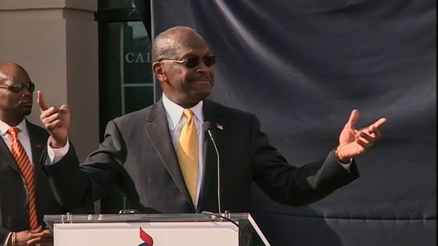 PHOTO: Herman Cain Says He's Suspending Campaign