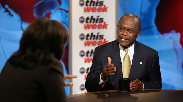 PHOTO: GOP candidate Cain discusses keeping up his campaign's momentum