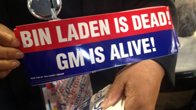 "PHOTO: Delegate holds up a ""Bin Laden Is Dead! GM Is Alive!"" bumper sticker at the Democratic National Convention."