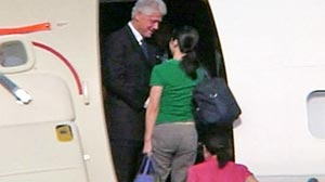 Photo: Former President Clinton Headed Home from North Korea with Journalists: Clinton Spokesman Says Former President Homebound, with Ling and Lee Onboard