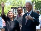 PHOTO: Presidential candidate Hillary Clinton and former President Bill Clinton march in Chappaquas Memorial Day parade on May 25, 2015.