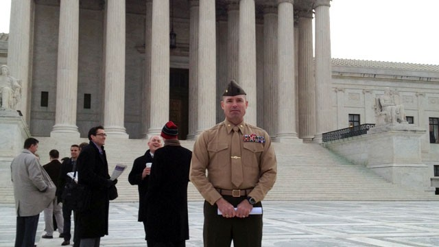 PHOTO: Major David McCombs , U.S. Marine Corps, standing in line to hear arguments before the U.S. Supreme Court on whether the government can make it a crime to lie about war medals.