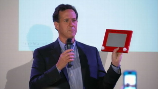 VIDEO: Rick Santorum, Newt Gingrich attack Mitt Romney by using an Etch-A-Sketch.